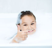 Girl bathes in a bathroom Royalty Free Stock Photo