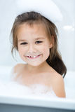 Girl bathes in a bathroom Royalty Free Stock Images