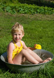 Girl bathes in a bucket Royalty Free Stock Photos