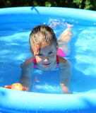 Girl bathes in inflatable pool Stock Photo