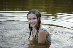 The girl bathes in lake Stock Images