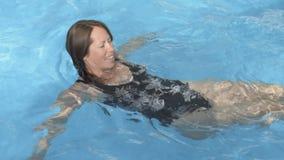 Girl bathes in pool stock video