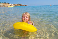 Girl bathes in the red sea Stock Images