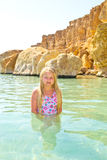 Girl bathes in the red sea Royalty Free Stock Image