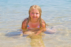 Girl bathes in the red sea Stock Image