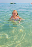 Girl bathes in the red sea Stock Photography