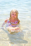 Girl bathes in the red sea Stock Photos