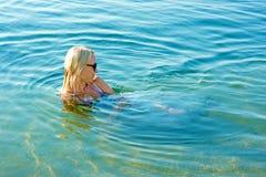 Girl bathes seaborne Stock Images
