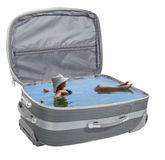 Girl bathes in a suitcase Stock Photography