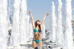 Girl bathing in a fountain Royalty Free Stock Photos
