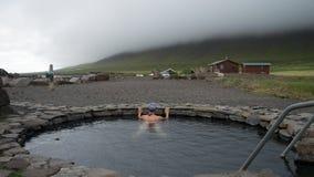 Girl bathing in natural hot spring Stock Image