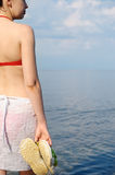 The girl in a bathing suit against the sea Stock Photo