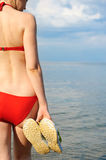 The girl in a bathing suit against the sea Stock Photography