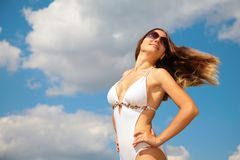 Girl in bathing suit with being fluttered hair Stock Photos