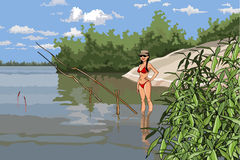 Girl in a bathing suit is fishing on the river Royalty Free Stock Photo