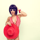 Girl in a bathing suit and hat Royalty Free Stock Image
