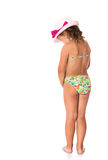 Girl in a bathing suit and hat. Shy, petite, tanned girl in a bathing suit and hat turned his back to the camera, and dropped down head - Isolated on white Stock Photos