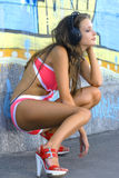 Girl in bathing suit is listening music Stock Photography