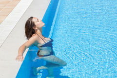 The girl in a bathing suit at the pool . Stock Photography