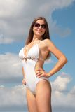 Girl in bathing suit and sunglasses Royalty Free Stock Photography