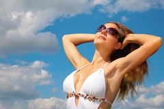 Girl in bathing suit and sunglasses Stock Image
