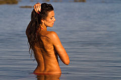 Girl bathing in water at dawn Stock Photography