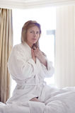 Girl in bathrobe. Portrait of a beautiful girl in a bathrobe Stock Photography