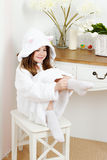Girl in a bathrobe Stock Photos