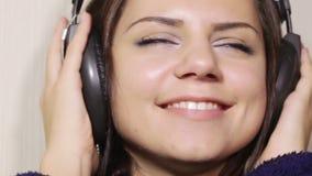 Girl bathrobe in headphones CU stock footage