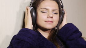 Girl bathrobe in headphones stock video