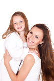 Girl in bathrobe and her mother Royalty Free Stock Photos