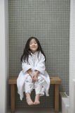 Girl In Bathrobe Sitting On Bench By Bathtub Stock Image