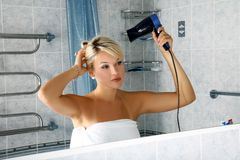 Girl in bathroom Royalty Free Stock Images