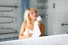 Girl in bathroom Royalty Free Stock Photo