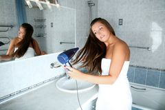 Girl in bathroom Stock Images