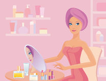 Girl in bathroom. The girl in bathroom does make-up Stock Image