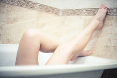 Girl in the bathroom Stock Images
