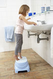 Girl In Bathroom Brushing Teeth Royalty Free Stock Photos