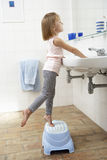 Girl In Bathroom Brushing Teeth Stock Images