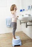 Girl In Bathroom Brushing Teeth Stock Photos
