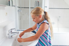 Girl in bathroom Royalty Free Stock Image
