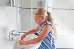 Girl in bathroom Royalty Free Stock Image