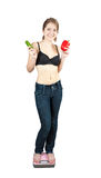 Girl on bathroom scales Stock Images