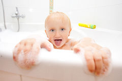 Girl in a bathtub Royalty Free Stock Photos