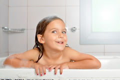 Girl in a bathtub Royalty Free Stock Image