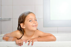 Girl in a bathtub Stock Images