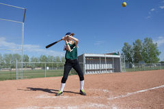 Girl batting a ball Royalty Free Stock Images