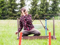 Girl be lost in thought about hurdles for rabbits Stock Photography