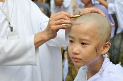 Girl be removed hair to become a nun during a Buddhist ordinatio Stock Photo