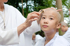 Girl be removed hair to become a nun during a Buddhist ordinatio Royalty Free Stock Photos